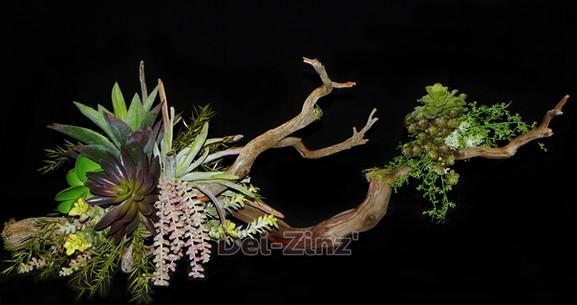 faux succulent arrangement on driftwood