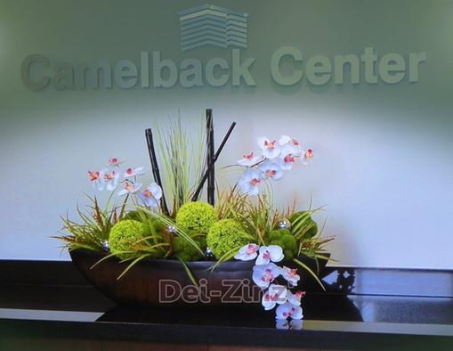 silk orchid reception desk arrangement