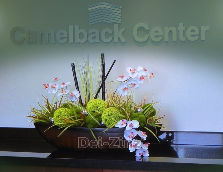 silk orchid reception desk arrangement