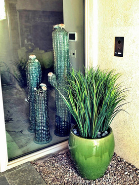 potted-plastic-grass-at-main-entry-to-residence