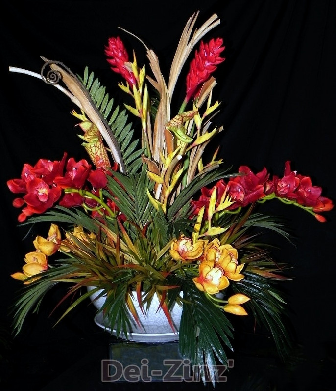 faux orchid arrangement with palm