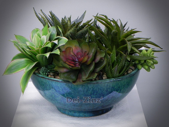faux succulent garden in teal bowl