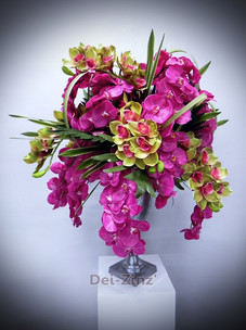 pink and yellow orchids in silver goblet
