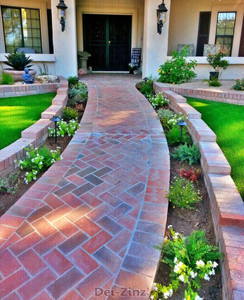 residental-walkway-bordered-with-outdoor-artificial-plants