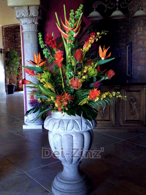 large tropical arrangement in concrete urn