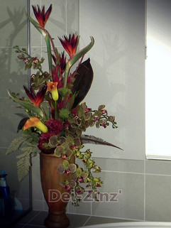 silk birds and orchids in bathroom