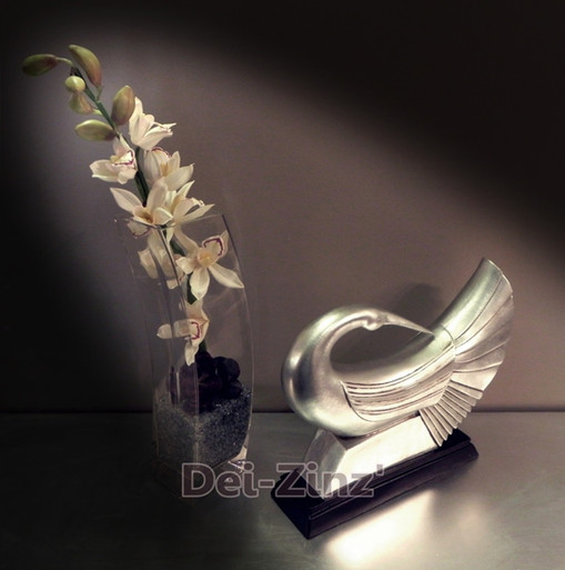 silk orchids with silver bird