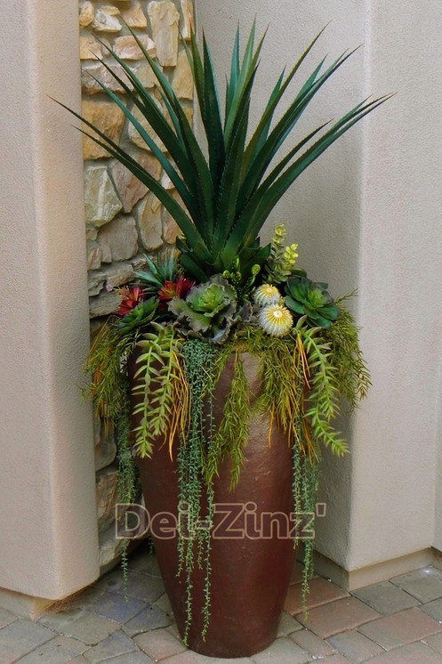 faux cacti and succulent entry arrangement