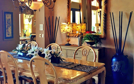silk-lilies-and-bamboo-poles-in-home-dining-room