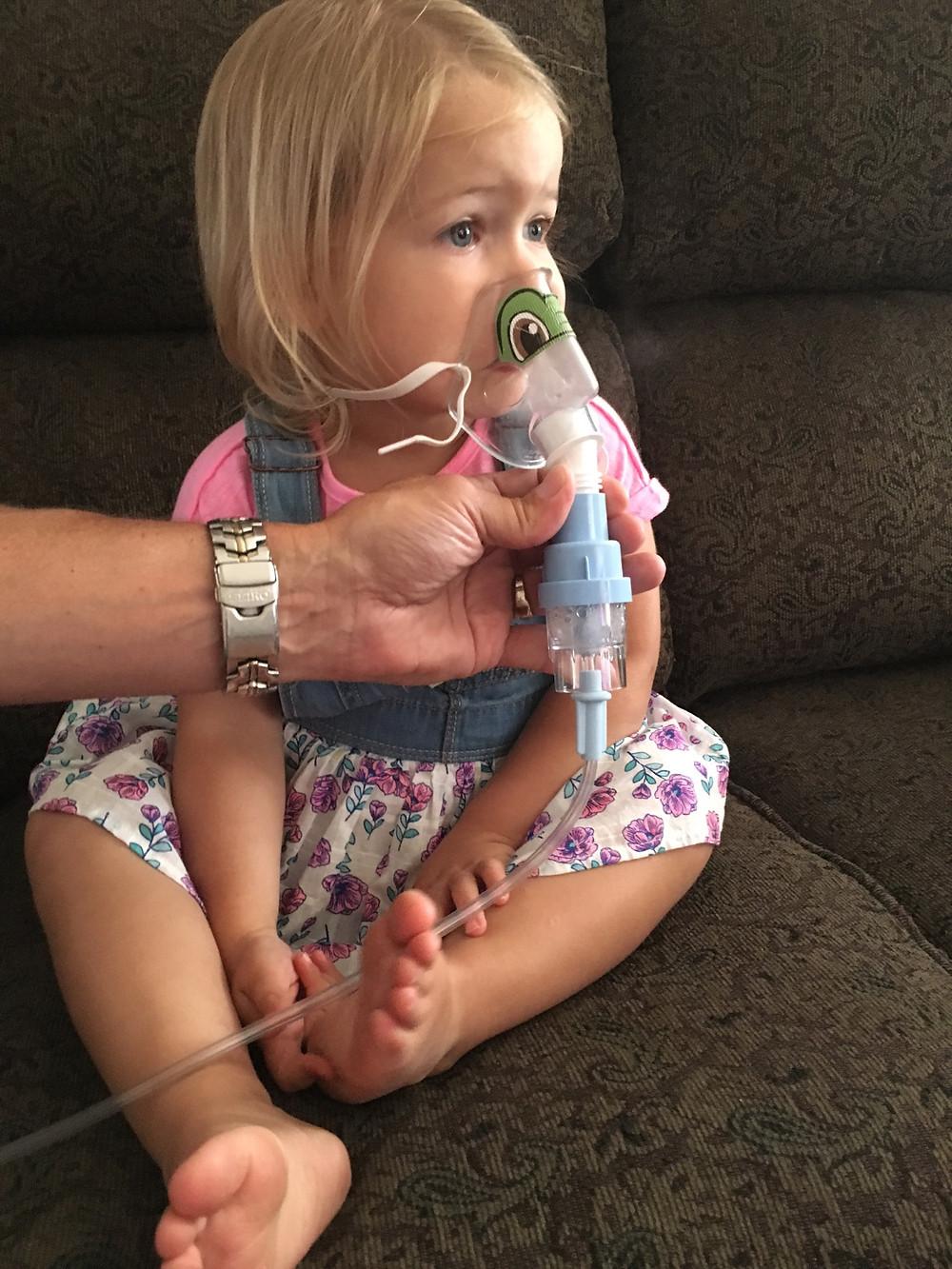 Avie on her nebulizer