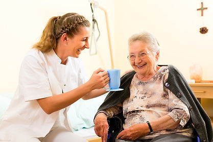 SilverBirch Healthcare carer helping with tea