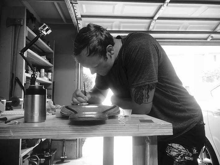 Bryce Vieth working on a longboard
