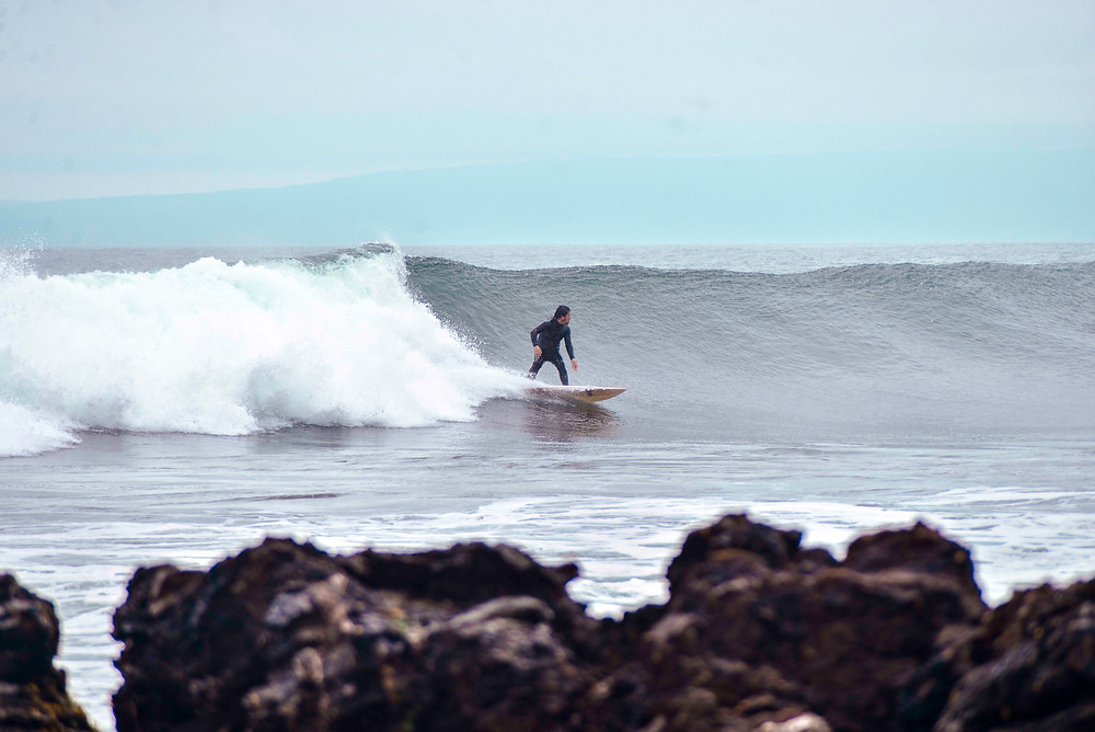 Guy surfing in Pichilemu