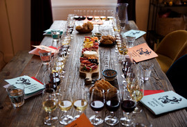 Beautiful spread of all our wine tasting glasses and a cheese and charcuterie board