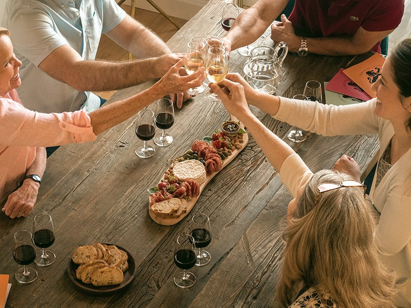 friends doing cheers about buying good wine