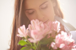 happy-woman-with-flowers-next-to-her-face_1098-2683