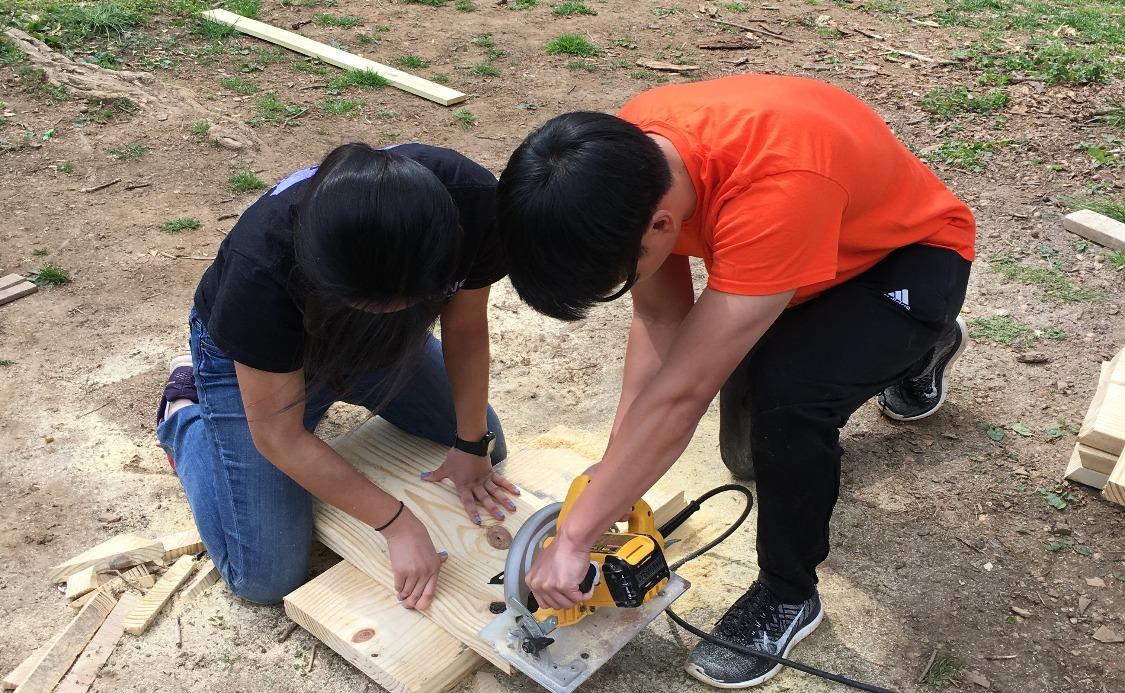Carefully cutting the wood