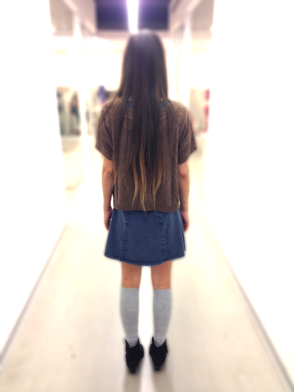 Girl staring down school hallway