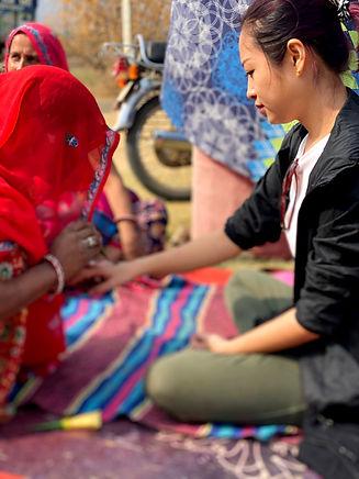 Indian Women Making Mehendi.jpg