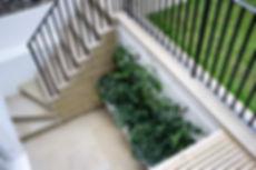 Karat Landscapes | Karat Gardens | Garden design | Garden build | basement garden | Plants | Hard landscaping | Green space | outdoor area | contemporary | Modern | Kensington | London yellow stock | brick boundaries | glass light wells | Sandstone | terrace area | lawn | lush | shade tolerant plants |