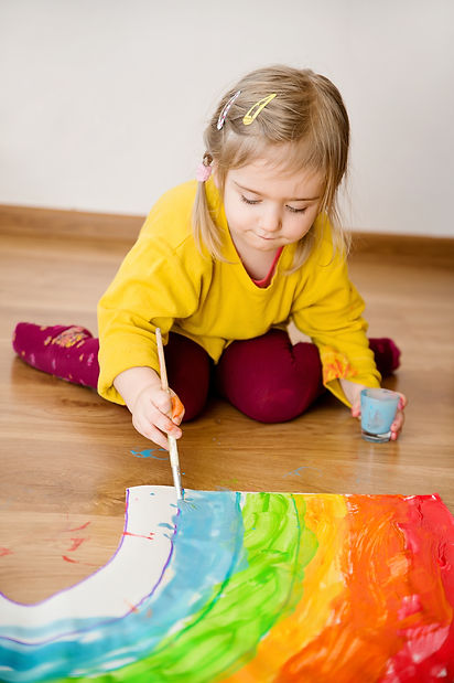 child draws a rainbow.jpg