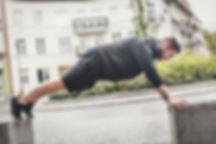 athletic-man-training-on-a-street-PVXVL5