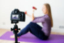 female-vlogger-recording-sports-related-