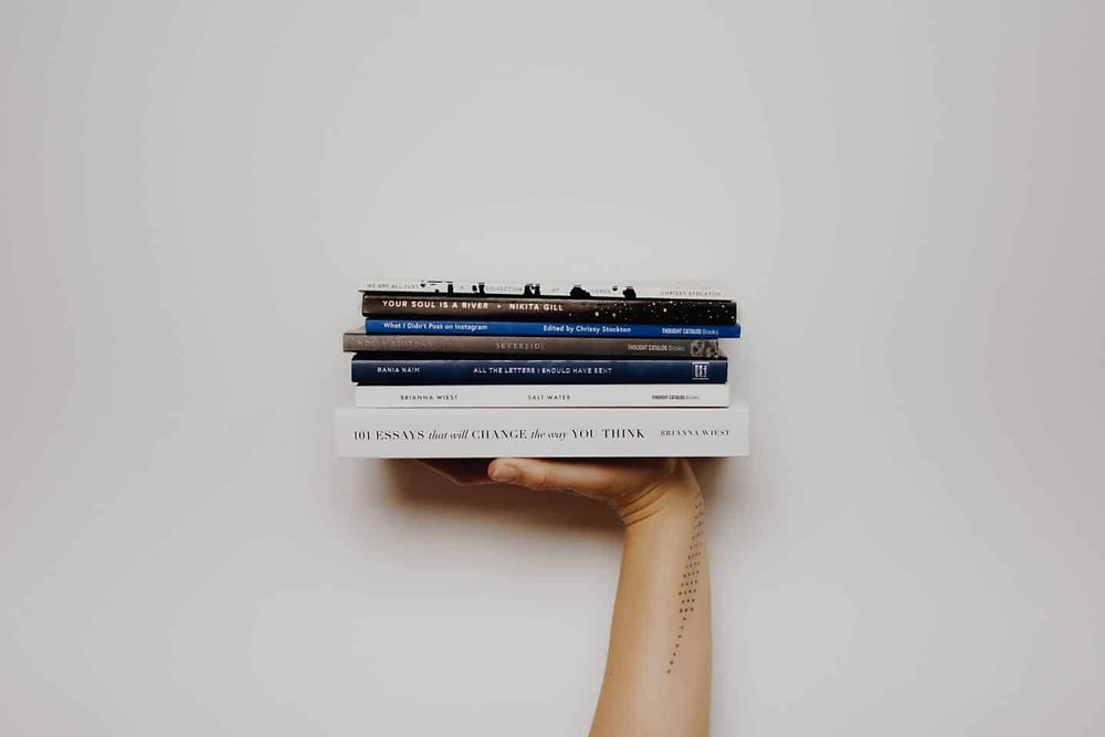 Hand with a stack of books