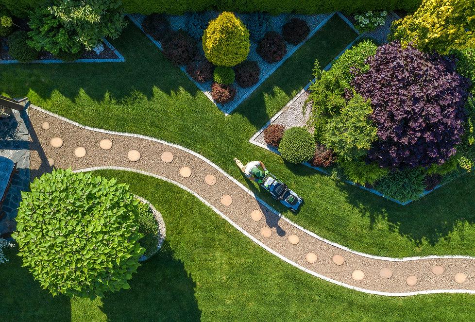 Caucasian Gardener with Grass Mower Trim