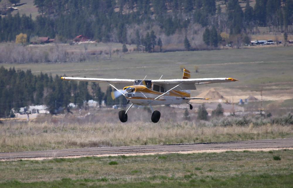 1976 Cessna 180J about to touch down