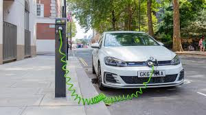 Image of car charging in street