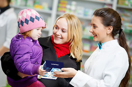 Pharmacist giving a child the v-comb