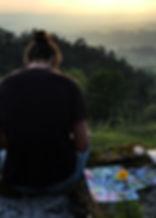 Artist attending art retreat draws dusk in Portugal