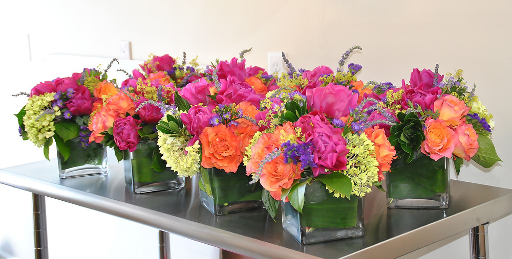 Hot pink peonies and orange roses wedding table centerpieces