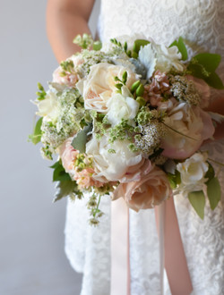 Peonies and roses wedding bouquet