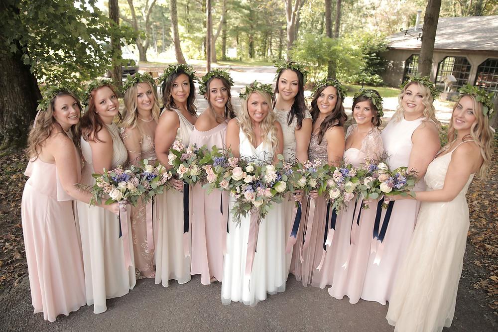 Bridesmaids wearing blush bridesmaids bouquet and flower crown