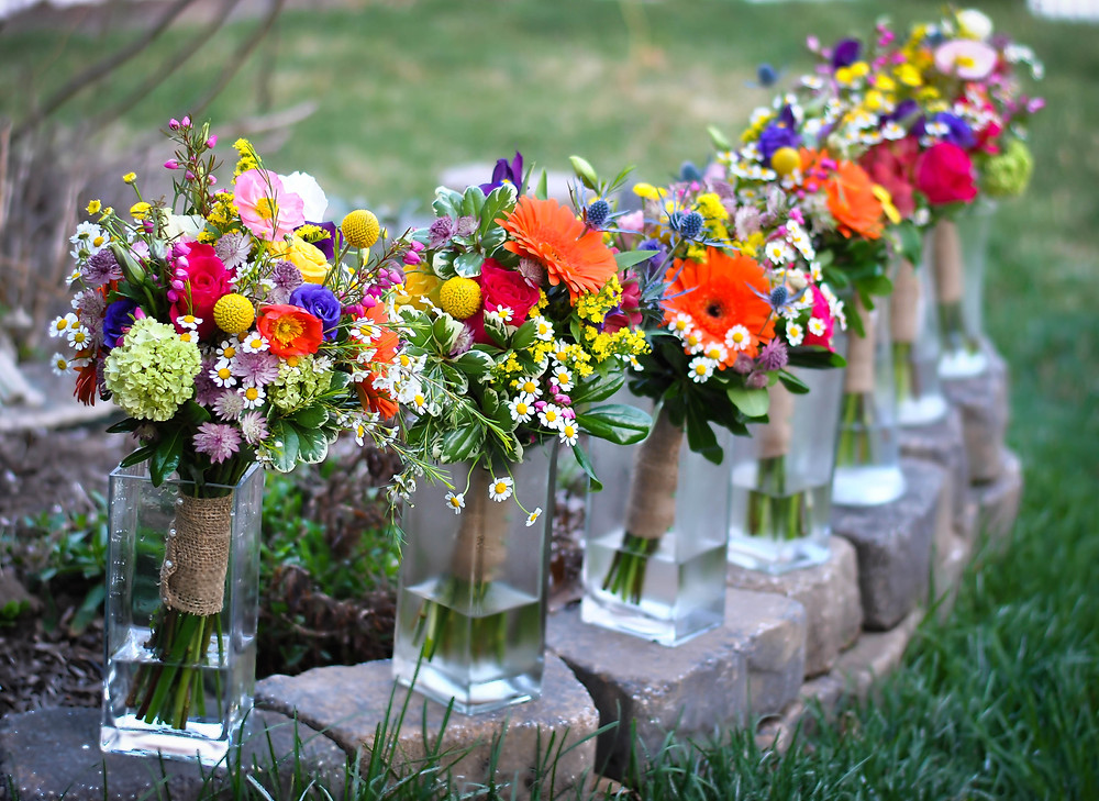 The bridesmaids spring garden-inspired bouquet with lots of  beautiful and vibrant color