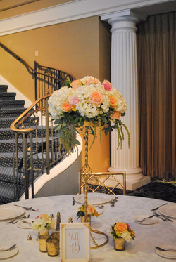 Peach pink and yellow wedding centerpiece at The Palace at Somerset