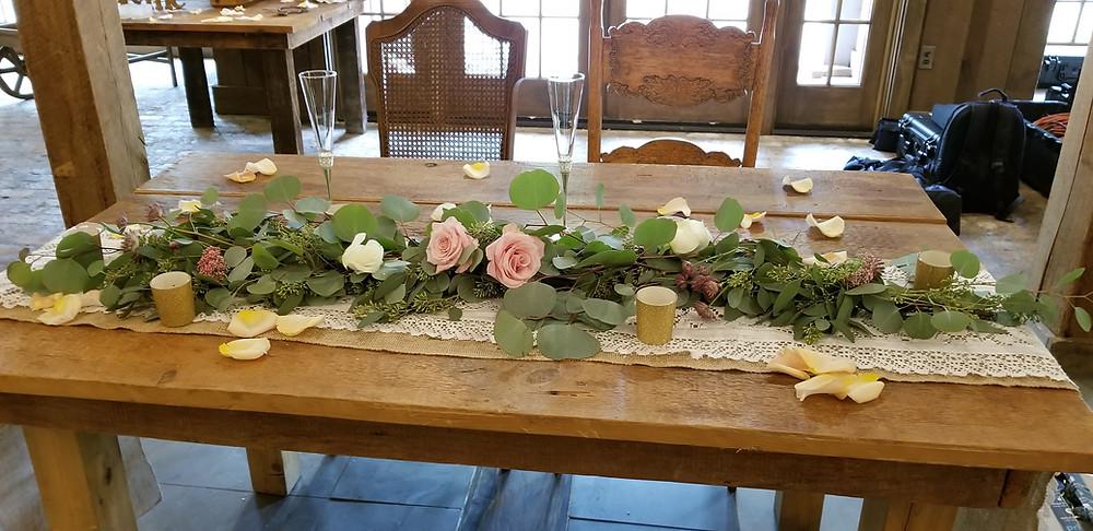 Rustic sweetheart table garland