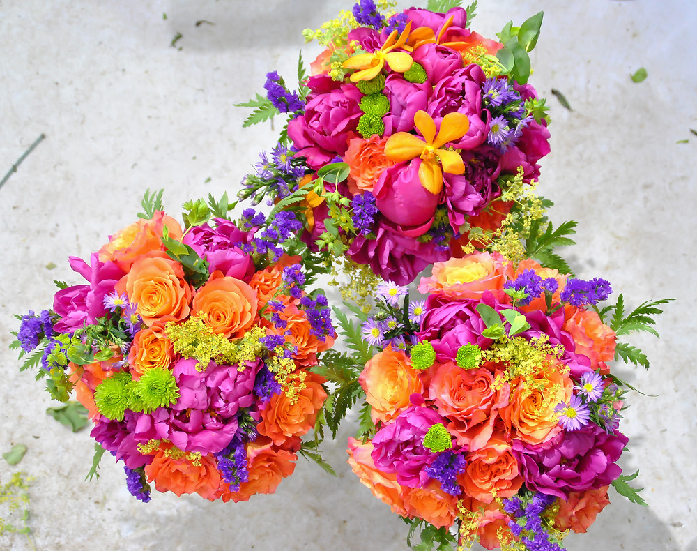 Hot pink peonies and orange roses summer wedding
