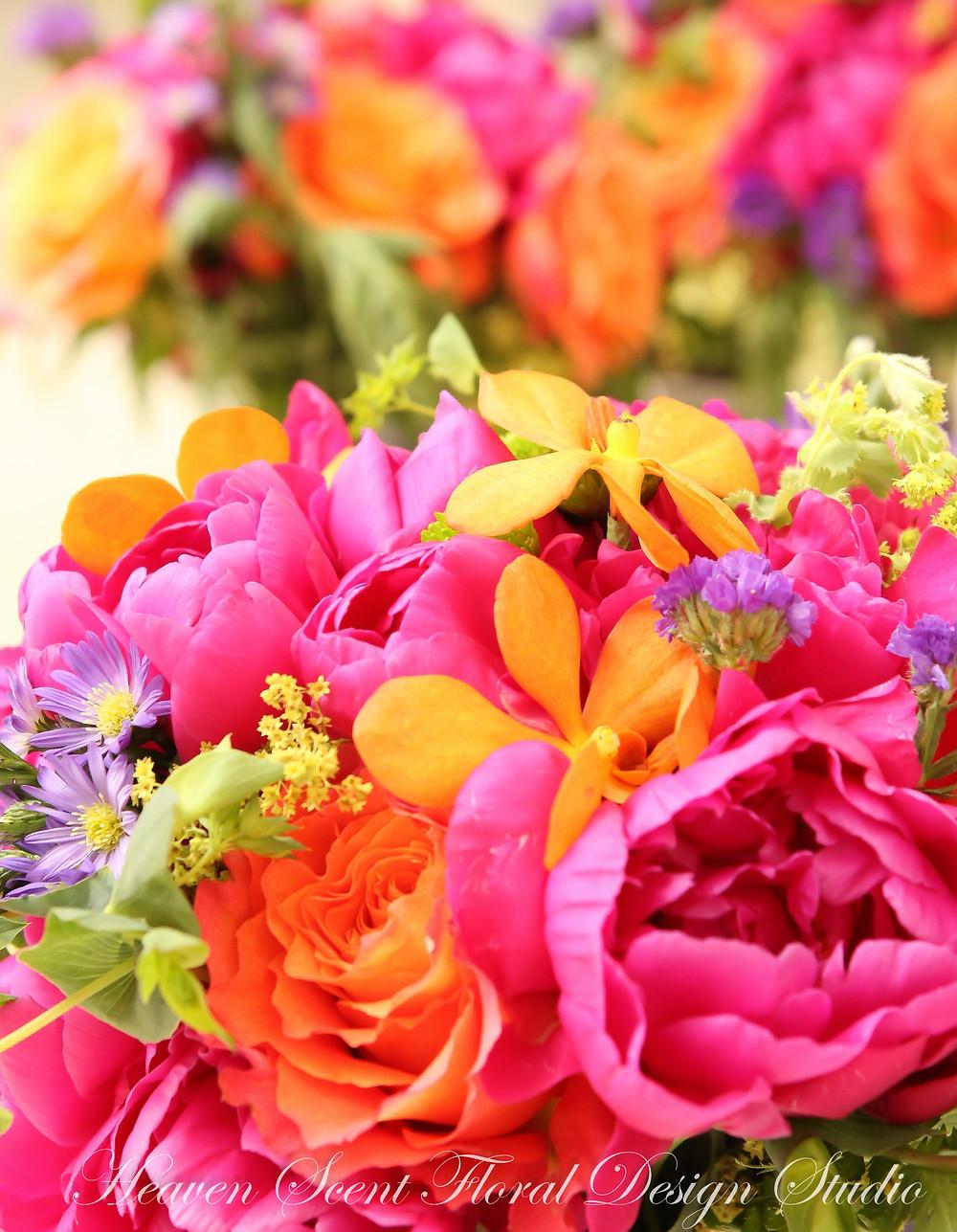 Magenta and orange summer wedding flowers