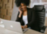 woman-in-black-blazer-sitting-on-black-o