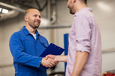 auto service, repair, maintenance, gesture and people concept - mechanic with clipboard an