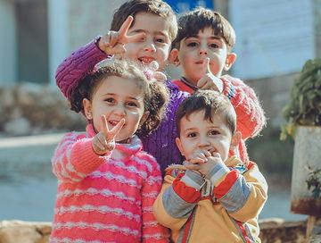 Four small children
