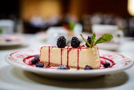 Cheesecake w/ Berry Sauce