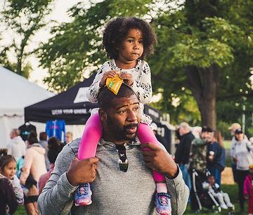 Little girl on Dad's shoulders