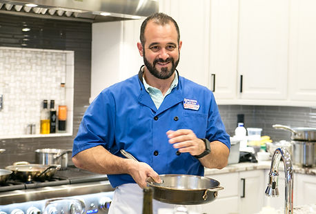 Chef Mark cooking in a home with a pan