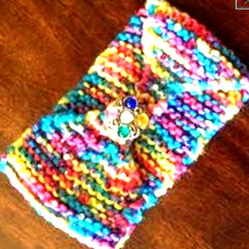 Rainbow Handknit headwrap with crystal button closure. One of a kind sustainable