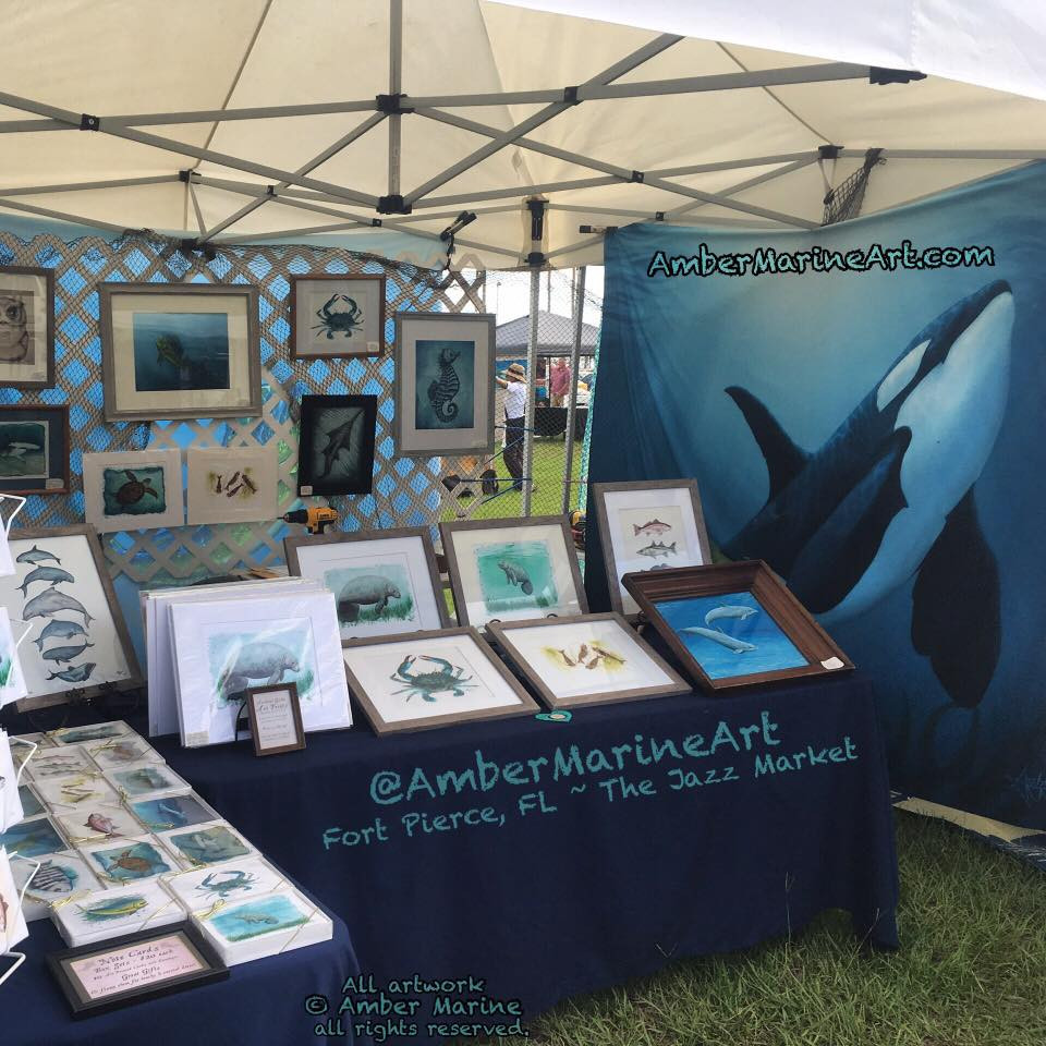 Amber Marine Wildlife Artist caravan/art show tent set up at the Fort Pierce Jazz Society Artisan Market (next to the Farmer's Market) in Fort Pierce Florida.