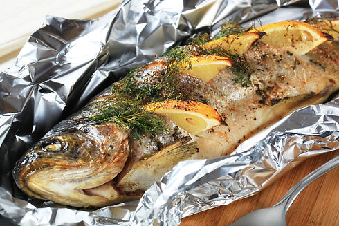 Oven baked trout stuffed with lemon and